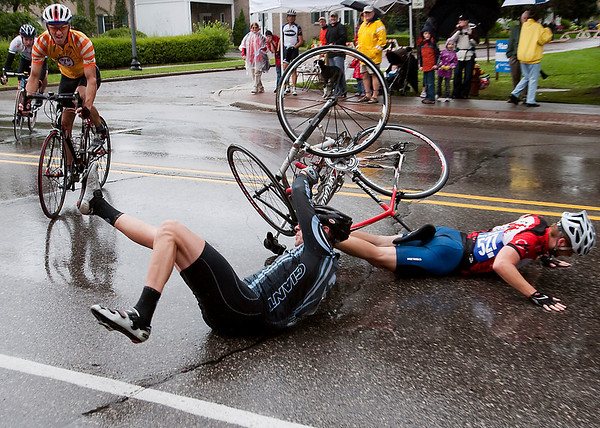 Record-Eagle/Douglas Tesner<br /> Cyclists Alexander Yockey, black, and Bradley Winkler hit the pavement after colliding during the men's category 5 race in the Cherry-Roubaix.