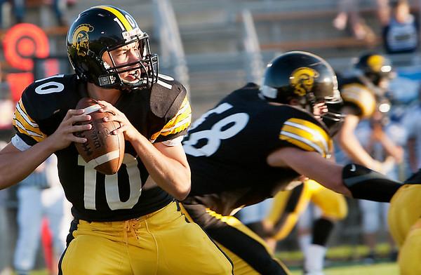 Record-Eagle/Douglas Tesner<br /> TC Central quarterback Mack Sovereign drops back for a pass Thursday.