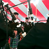 Record-Eagle/Douglas Tesner<br /> Shielded from rain showers, the Grand Traverse Pipes and Drums perform for the crowed under a tent at the Traverse City Microbrew & Music Festival.