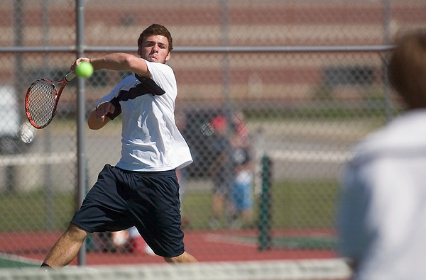 Record-Eagle/Jan-Michael Stump<br /> St. Francis' Sean Paquett volleys during his No.1 doubles match with Newton Calcutt, not pictured, against Leelanau's Wyatt Smith and Caleb Abbott in Wednesday's Traverse City St. Francis Invitational.
