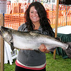 Record-Eagle/Dennis Chase<br /> Natalie Burke holds the 21.7-pound salmon she caught Friday morning.