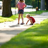 Record-Eagle photo/Jan-Michael Stump<br /> Kaylee Rindlisbacher, 6, left, watches her brother Jared, 2, draw with chalk in front of their aunt Lisa Pfeiffenerger's Eighth Street home on Monday evening in Traverse City. The two were visiting with their mother, Jackie and sister Alexis, 11, from Buckley.