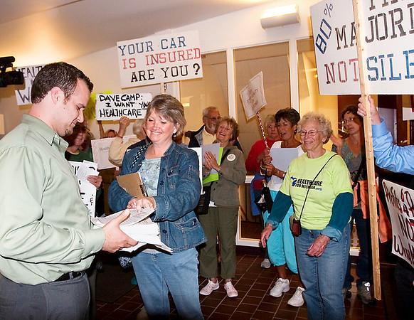 Record-Eagle/Douglas Tesner<br /> Health care demonstrators present Rep. Dave Camp's office with a petition featuring more than 4,000 signatures.