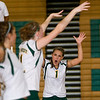 Record-Eagle photo/Jan-Michael Stump<br /> From left, Traverse City West's Kelly Flynn (4), Tayler Rodes (11) and Paige Johns (1) celebrate a point in Tuesday's win over Traverse City West.