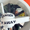 Record-Eagle photo/Jan-Michael Stump<br /> Coast Guard AMT2 Ted Mace does a post-flight inspection on one of Air Station Traverse City's five HH-65C helicopters on Friday afternoon. Traverse City is applying to be designated the tenth U.S. Coast Guard City in the country.