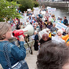 Record-Eagle/Douglas Tesner<br /> Demonstrators organize and head toward U.S. Rep. Dave Camp's office in Traverse City as they rally for health care reform Friday.