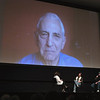 "Daniel Ellsberg speaks via Skype at Lars Hockstad Auditorium Saturday. ""The Most Dangerous Man in America"" was screened with filmmakers Judith Ehrlich, left, and Rick Goldman, center. Festival founder Michael Moore, right, moderates the discussion."