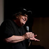 "Record-Eagle/Keith King<br /> Michael Moore talks to the crowd in Lars Hockstead Auditorium prior to revealing the ""Mike's Surprise"" movie Sunday at Central Grade School during the Traverse City Film Festival."