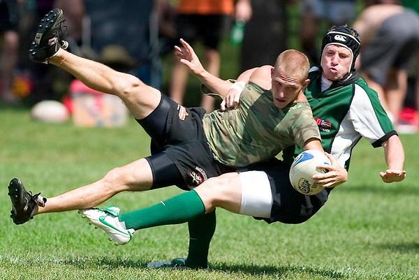 Record-Eagle/Jan-Michael Stump<br /> Michigan State's Adam Umstead chases down 3rd Halfers' Dale Blackmore in the championship game of the 39th annual Cherry Pit Rugby Tournament Saturday at the Grand Traverse Civic Center.