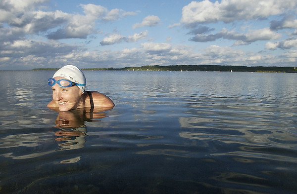 Record-Eagle/Garret Leiva<br /> Kathy Bradshaw swam the width of Grand Traverse Bay, beginning in Suttons Bay on Sunday. The open water swim was to raise money and awareness for Type I Diabetes; her mother, Terry and 10-year-old niece Alyssa Bradshaw live with the disease.