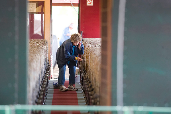 Record-Eagle/Jan-Michael Stump<br /> Betty A. Hogarth cleans the seats in a coach car pulled by a 1923 American locomotive Tuesday in preparation for The Buckley Old Engine Show, which runs through Aug 22.
