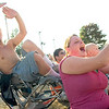 Record-Eagle/Jan-Michael Stump<br /> Matthew Brandon, left, and Katerina Wilson cheer while watching the Tough Truck Contest Saturday at the Northwestern Michigan Fair.