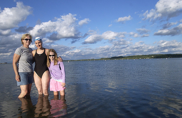Record-Eagle/Garret Leiva<br /> Kathy Bradshaw , center, swam the width of Grand Traverse Bay, beginning in Suttons Bay on Sunday. The open water swim was to raise money and awareness for Type I Diabetes; her mother, Terry, left, and 10-year-old niece Alyssa Bradshaw live with the disease.