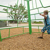 Record-Eagle/Jan-Michael Stump<br /> John Deloney, 7, plays on the new playground in Greilickville Harbor Park was built by Carter's Kids, a group organized by television builder and Traverse City native Carter Oosterhouse.