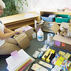 Record-Eagle/Keith King<br /> Lita Ferdinand, of Suttons Bay, opens boxes of school supplies Monday, August 16, 2010 that she will use as she teaches at the Leelanau Montessori Public School Academy this coming school year.