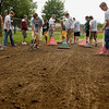 Record-Eagle photo/Jan-Michael Stump<br /> Traverse City West football players rake the dirt behind the visitor's bleachers at Thirlby Field on Friday afternoon. Football players from Traverse City Central, Traverse City St. Francis and West worked to get Thirlby Field ready for the upcoming season.