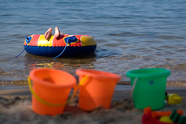 Record-Eagle photo/Jan-Michael Stump<br /> Connor Whyte, 7, of Rockford, floats on a tube at the Traverse City State Park beach on Grand Traverse Bay's east arm. Whyte, who was visiting his grandmother Nancy Whyte, of Traverse City, was not able to swim on two visits last summer because of no-swim advisories.