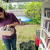 Record-Eagle photo/Jan-Michael Stump<br /> Hannah Stone sorts through items for the garage sale.
