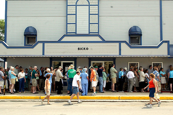 """Record-Eagle file photo/Jan-Michael Stump<br /> People wait in line to see the 2007 premiere of Michael Moore's documentary, """"Sicko,"""" in Bellaire."""
