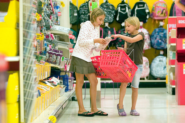 "Record-Eagle photo/Jan-Michael Stump<br /> Christy Davis and her daughters Quincy, 8, and Maysa, 6, shop for school supplies at Target on Monday afternoon. The family lives in Traverse City during the summer, but spends the school year in Flushing. We always do our shopping in Traverse City, said Christy, who said the family moves back downstate the day before the girls start classes at Central Elementary School. ""I like to let them feel prepared and excited about school,"" said Davis, who also teaches at that school."