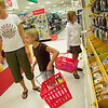 Record-Eagle photo/Jan-Michael Stump<br /> Christy Davis and her daughters Maysa, 6, left, and Quincy, 8, shop for school supplies at Target on Monday afternoon.