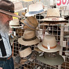 Record-Eagle/Douglas Tesner<br /> Kenneth Duke strolls past the Diversions hat display during the annual downtown Street Sale as he shopped along Front Street.
