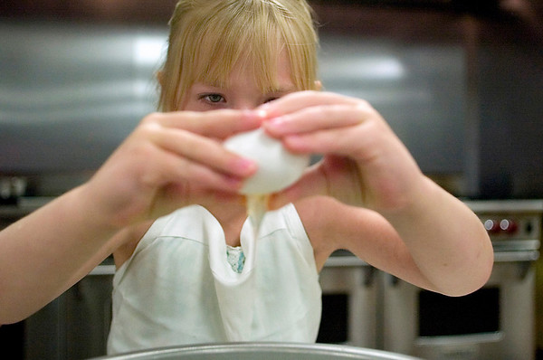 Record-Eagle photo/Jan-Michael Stump<br /> Riley McKenna, 6, cracks an egg in her Kids in the Kitchen class.