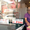Record-Eagle/Douglas Tesner<br /> Manager Kathy Brewer adjusts film festival display items in the American Spoon on Front Street.