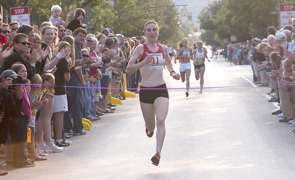 Record-Eagle/Douglas Tesner<br /> Nicole Edwards, of Winnipeg, Canada, is first at the finish line at the by-invitation-only Stars of the Mile race in downtown Traverse City Saturday. The race featured five female and five male elite runners. The winners in each race received $1,000.