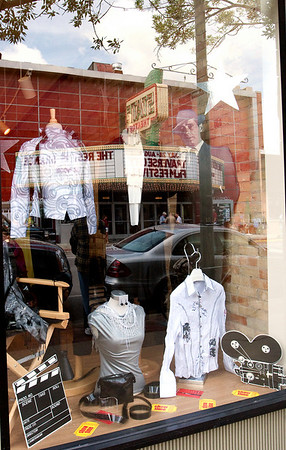 Record-Eagle/Douglas Tesner<br /> The State Theatre is reflected in the window of Muriel's Clothing on Front Street.