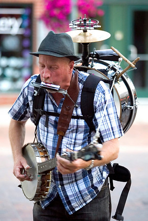 "Record-Eagle photo/Jan-Michael Stump<br /> ""Mr. JoJangles"" performs on West Front Street during the Traverse City Film Festival."