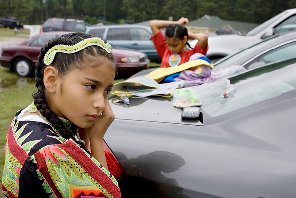 Record-Eagle/Keith King<br /> Tiana Schocko, left, 11, of Suttons Bay, and her sister, Vanessa Schocko, 12, prepare for the Grand Traverse Band of Ottawa and Chippewa Indians' annual Traditional Powwow on Saturday.