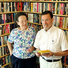 Record-Eagle/Vanessa McCray<br /> Sallie Gardner, left, and Central Lake District Library Director Dick Williams stand in a book-lined room inside a used book shop run by the library's friends group. Volunteers select books from this collection to send to troops serving overseas.