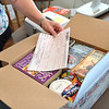 Record-Eagle/Vanessa McCray<br /> Sallie Gardner, a member of the friends group that supports the Central Lake District Library, shows a box of books ready to be shipped to troops serving overseas.