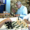 Record-Eagle/Lisa Perkins<br /> Chris Remsperger, left, challenges Alma Vorhauer to a chess match at the Traverse City Senior Center while Sam Vorhauer, back right, provides some instruction in the game.