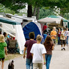 Record-Eagle/Keith King<br /> Kids and goats walk past campsites Saturday at the Northwestern Michigan Fairgrounds.