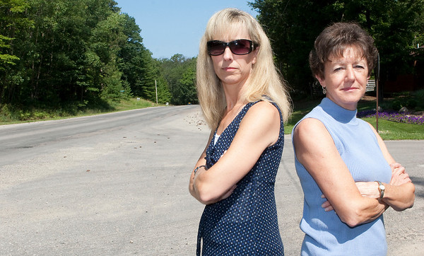 Record-Eagle/Douglas Tesner<br /> Kay Lassila and Renee Kaufman stand on Holiday Road at the Acme, East Bay township line.