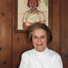 Record-Eagle/Loraine Anderson<br /> Helen Tanner, 93, at her summer home near Beulah.  The painting behind her was done by a friend in the 1930s after a tennis game when she was in her 30s.  She takes it with her when she moves from summer home to winter residence in Florida.