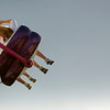 Record-Eagle photo/Jan-Michael Stump<br /> Fairgoers take in the amusement rides at the Northwestern Michigan Fair.