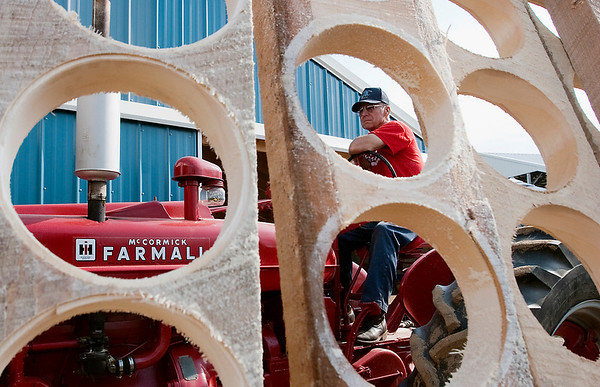 Record-Eagle/Douglas Tesner<br /> Everett Youker uses power from a 1946 Farmall to produce wooden bowls at the 42nd annual Buckley Old Engine Show. The show runs through the 16th.
