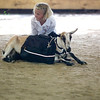 "Record-Eagle photo/Jan-Michael Stump<br /> ""He's been really tired lately; he's been showing all day,"" said Kirsi Wildfong, 9, after her goat Snowflake decided to take a break in the beginner goat-packing obstacle course on Sunday at the Northwestern Michigan Fair."