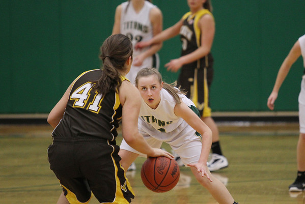 Record-Eagle/Keith King<br /> Traverse City West's Katie Placek defends Ogemaw Heights' Jena Noble at TC West on Friday.