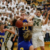 Record-Eagle/Jan-Michael Stump<br /> Midland's Joseph Vieau (33) battles Traverse City West's Jeremiah Williams (12) and Trevor Commissaris (24).