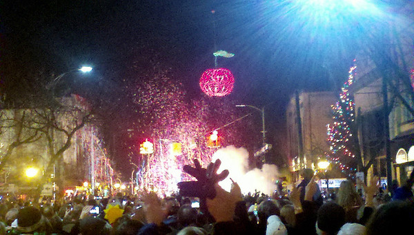 Record-Eagle file photo/Jan-Michael Stump<br /> People celebrate as the Cherry Ball drops at the intersection of Front and Cass streets as 2011 begins.