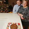 Record-Eagle/Keith King<br /> Craig and Jinny O' Connor, of Traverse City, stand in their kitchen near a fruit cake they refer to as a Wakefield Cottage Christmas Cake.