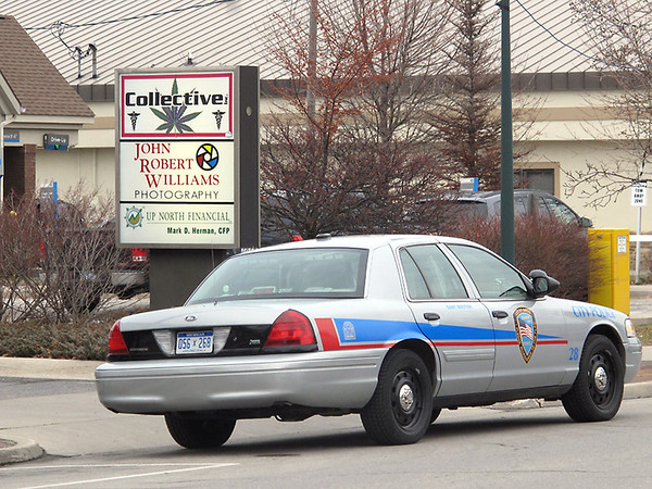 Record-Eagle Photo/Art Bukowski<br /> A Traverse City Police Department car sits outside Collective Inc. on State Street on Tuesday afternoon.
