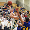 Record-Eagle/Jan-Michael Stump<br /> Traverse City West's Donny Cizek (11) drives to the basket in the first half of Tuesday's game against Midland.