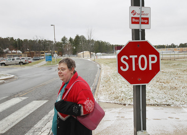 Record-Eagle/Keith King<br /> Christina Mikowski, of Traverse City, waits at Northwestern Michigan College on Friday at a Bay Area Transportation Authority stop.