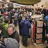 Record-Eagle/Keith King<br /> Beer is consumed and merchandise is looked at as Backcountry Outfitters bustles with activity Thursday during Men's Night in downtown Traverse City.