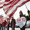 "Record-Eagle/Keith King<br /> Troy Gerring, of South Boardman, holds a handmade sign of gratitude for the battlefield sacrifice of Jackie Lee Diener II as Daylon Robbins, right, of Walloon Lake, and others hoist American flags outside Boyne City High School before  Saturday's ""Celebration of Life"" ceremony for Army Pvt. Jackie Lee Diener II, of Boyne City, who died in Afghanistan just two months into his his tour of duty."
